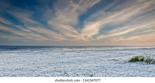 A panoramic view of dramatic clouds at dusk, over the Atlantic Ocean, as seen from the beach on Hilton Head Island, SC.