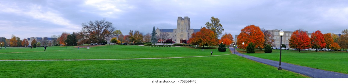 Panoramic view of Drillfield with Burrus Hall in the background during the fall with orange and maroon colors, at Virginia Tech University, Virginia, USA
