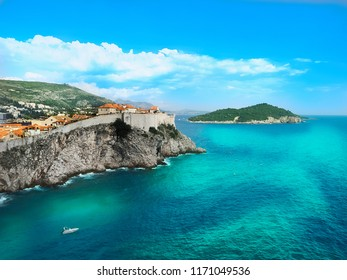 Panoramic view of Dubrovnik old town walls and Lokrum island in a summer day. Dubrovnik, Croatia