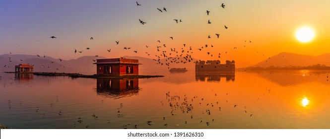 Panoramic view during Sunrise at the Jal Mahal 'Water Palace'. It is an architectural showcase of Rajput style in the Man Sagar lake in jaipur city, the capital of Rajasthan, India.