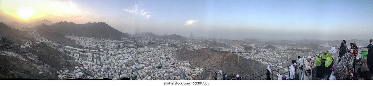 "Panoramic view during sunrise from the peak of Mount ""Jabal an-Nour"" as translated in English The Mountain of Light is a mountain near Mecca in Saudi Arabia whereby the Hira Cave is located."