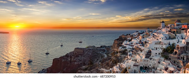 Panoramic view during sunset time over the village of Oia on Santorini Island in Greece