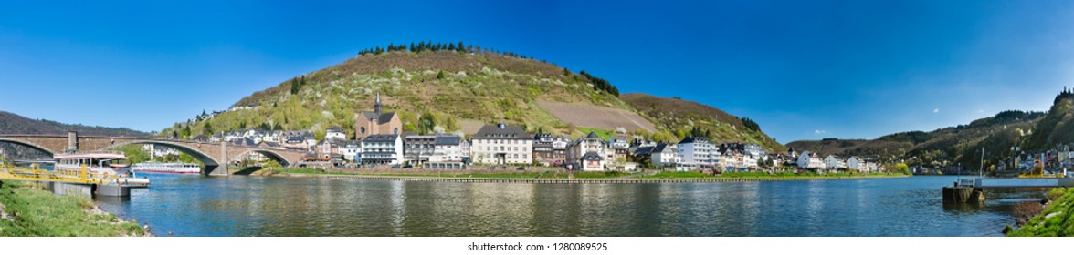 Panoramic view of the eastern shore of Cochem in the Eifel over Moselle River in Germany.