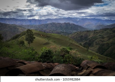 Panoramic view of the Ecuadorian sierra from the roof of a house. There are big clouds, mountains, shrubs and trees. Vilcabamba, Loja. Ecuador