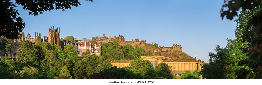 Panoramic view of Edinburgh Castle and The Scottish National Gallery above Princes Street Gardens. Scotland, UK