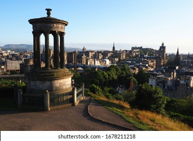 panoramic view of Edinburgh with the sun setting