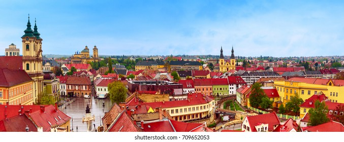 Panoramic view of Eger city, Hungary with red roofs and blue sky. Travel european town background