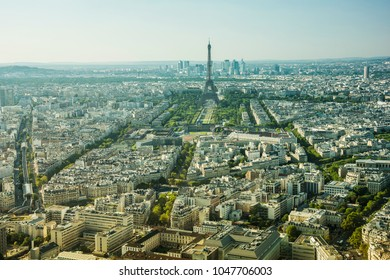 Panoramic view of the Eiffel tower, the famous landmark of Paris. Paris, France, Europe. The business district La Defense is in the background.