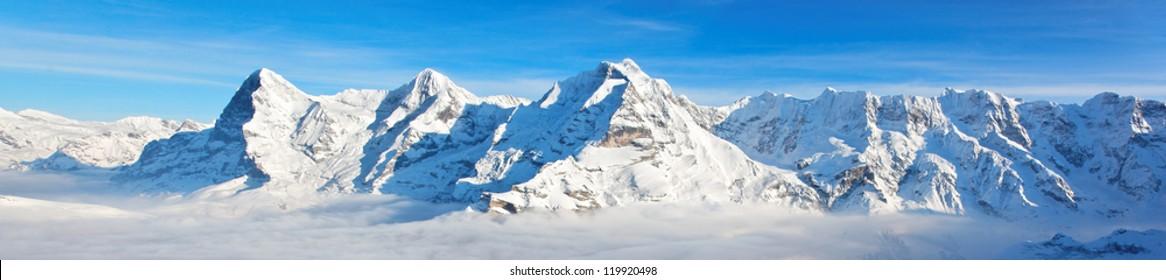 Panoramic view of Eiger, Monch and Jungfrau massif, Swiss Alps, Switzerland, Europe