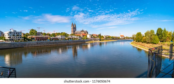 Panoramic view of Elbe, cathedral, old and modern town in Magdeburg, Autumn morning, sunny day, clouds, wide angle, blue sky