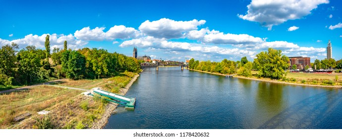 Panoramic view of Elbe, old and new town, bridge in Magdeburg, Germany, Autumn, blue cloudy sky