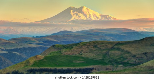 Panoramic view of Elbrus mountain in late evening.