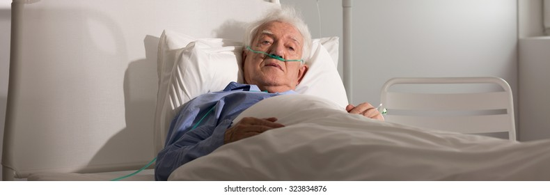 Panoramic view of an elder man in hospital bed