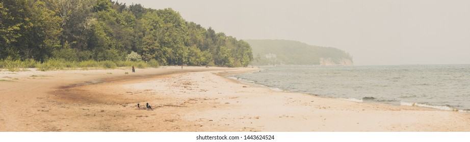 Panoramic view of empty sandy beach in summer day. Vacation over Baltic sea.