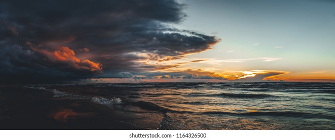 Panoramic view, Evening by the sea, view on seaside in sunset, dramatic storm clouds in background