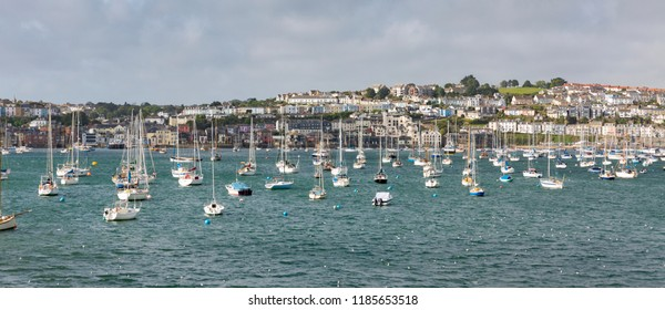 Panoramic view of Falmouth harbourside with colourful buildings and moored boats.