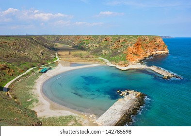 Panoramic view of the famous beautiful and  tranquil golden sand beach on Bulgarian Black sea coast in the beginning of the summer.