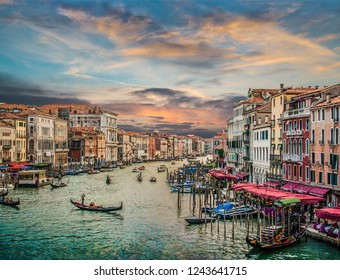 Panoramic view of famous Canal Grande from famous Rialto Bridge at sunset in Venice, Italy with retro vintage Instagram style pastel filter effect