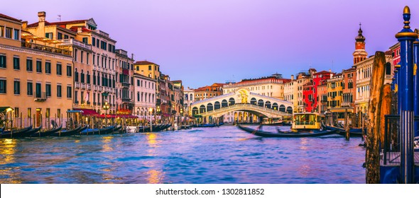 Panoramic view of famous Canal Grande of famous Rialto Bridge at sunset in Venice, Italy.