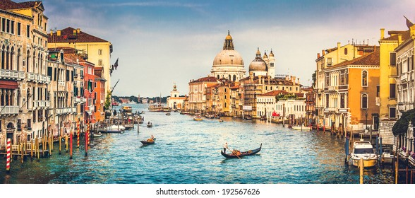 Panoramic view of famous Canal Grande and Basilica di Santa Maria della Salute at sunset in Venice, Italy with retro vintage Instagram style filter effect