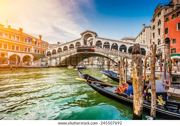 Panoramic view of famous Canal Grande from famous Rialto Bridge at sunset in Venice, Italy with retro vintage Instagram style filter effect