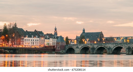 Panoramic view at the famous Dutch Sint Servaas bridge with lights in the city center of Maastricht