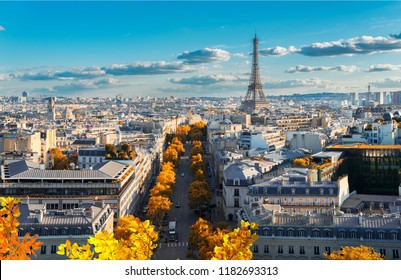 panoramic view of famous Eiffel Tower and Paris roofs at fall, Paris France