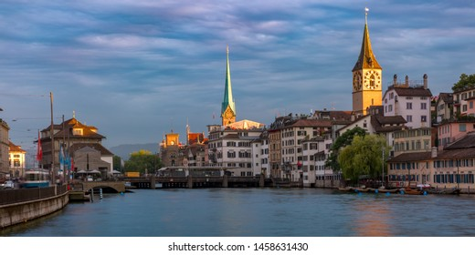 Panoramic view of famous Fraumunster and Church of St Peter and river Limmat at sunset in Old Town of Zurich, the largest city in Switzerland