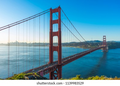 Panoramic view of famous Golden Gate Bridge seen from Battery Spencer viewpoint during sunrise in San Francisco, California, USA.