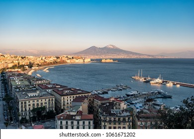 Panoramic view of the famous gulf of Naples, with the Vesuvius on Background at sunset