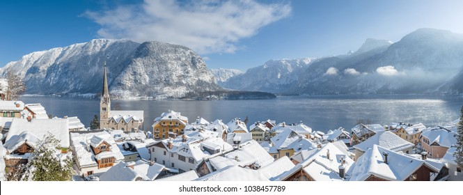 Panoramic view of famous Hallstatt lakeside town in the Austrian Alps on a beautiful cold sunny day with blue sky and clouds in winter, Salzkammergut, Upper Austria region, Austria