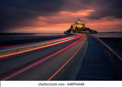 Panoramic view of famous historic Le Mont Saint-Michel tidal island in sunset, Normandy, northern France