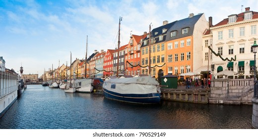 """Panoramic view of the famous Nyhavn city during the Christmas holidays with christmas ornament. In Danish it means """"new harbor""""  (Europe - Denmark - Copenhagen) - People are not recognizable"""