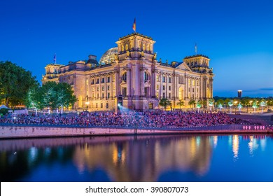 Panoramic view of famous Reichstag building, seat of the German Parliament (Deutscher Bundestag), with Spree river in twilight during blue hour at dusk, Berlin Mitte district, Berlin, Germany