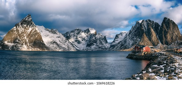 Panoramic view of the famous tourist attraction Hamnoy fishing village on Lofoten Islands, Norway with red rorbu house in winter