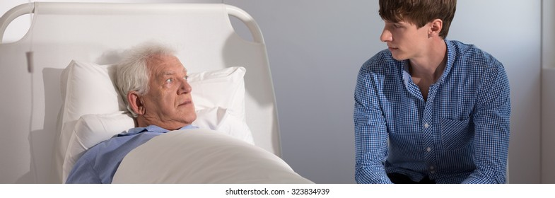 Panoramic view of father and son in hospital room