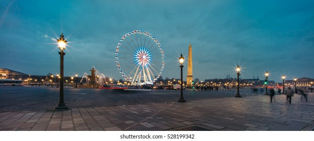 Panoramic view of Ferris wheel and the Luxor Obelisk on the Concorde square  in the Christmas time at night. The Luxor Obelisk is originally located at the entrance to Luxor Temple, in Egypt.