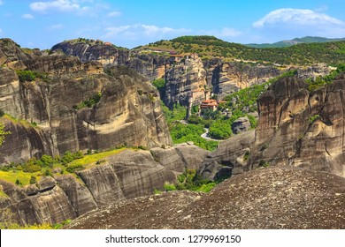 Panoramic view of few Meteora monasteries on the high cliff rock in the mountains at spring time, Greece