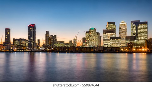 Panoramic view of the financial district Canary Wharf in London after sunset