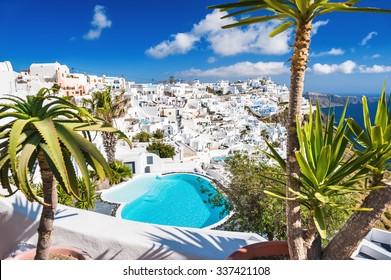Panoramic view of Fira town. White architecture on Santorini island, Greece.