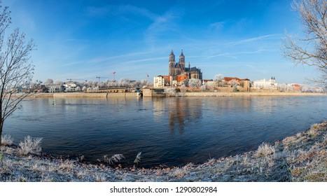 Panoramic view of first frost over amazing sunrise in Magdeburg downtown in Winter, Germany