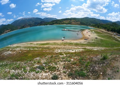 Panoramic view with fisheye effect of Lake Turano in Italy during the summer