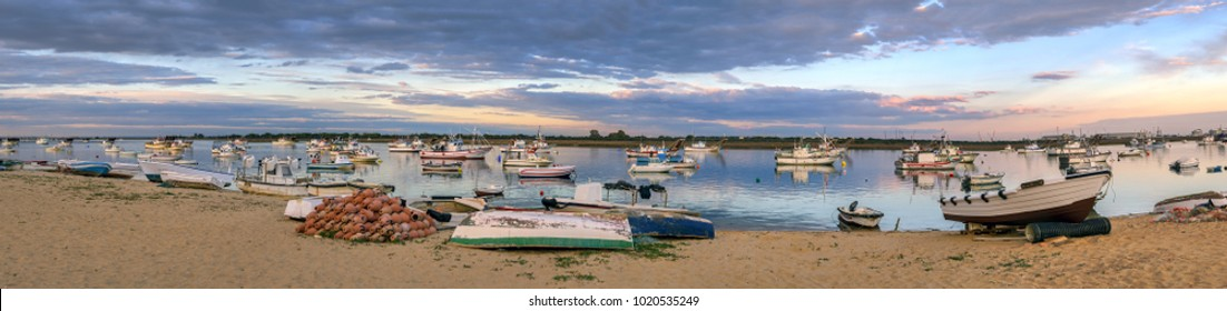 Panoramic view of fishing boats on Odiel river in Punta Umbria, Andalusia, Spain.