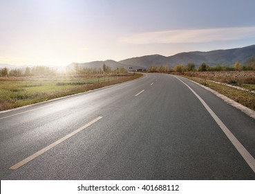 Panoramic view of foothills road with mountains