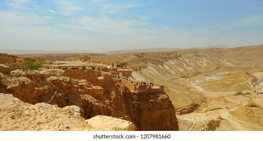 Panoramic view of the fortification of Masada and the Judaean Desert in Israel, during a sunny and very hot day.
