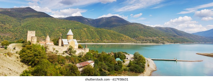 Panoramic view of the fortress and churh Ananuri, standing on the shore of the reservoir Zhinvali. Georgia