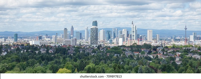 Panoramic view of Frankfurt cityscape and green forest