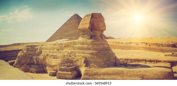 Panoramic view of the full profile of the Great Sphinx with the pyramid in the background in Giza. Egypt. Filtered image:cross processed lomo effect.