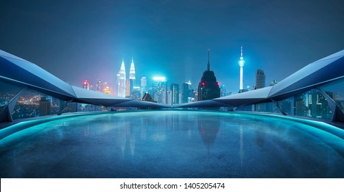 Panoramic view of futuristic geometric shapes design empty floor with Kuala Lumpur city skyline . Night scene .