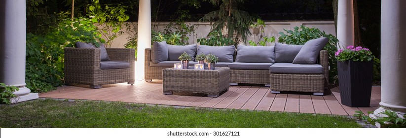 Panoramic view of garden patio with furniture